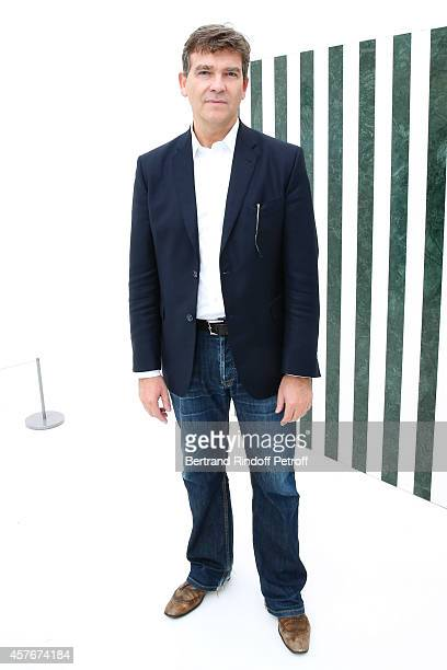 Politician Arnaud Montebourg poses front of a Buren work during the FIAC 2014 International Contemporary Art Fair Official Opening at Le Grand Palais...
