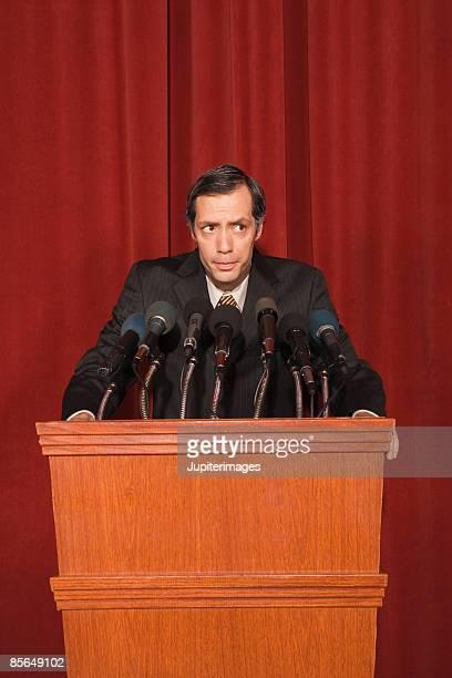 politician behind podium - あがり症 ストックフォトと画像