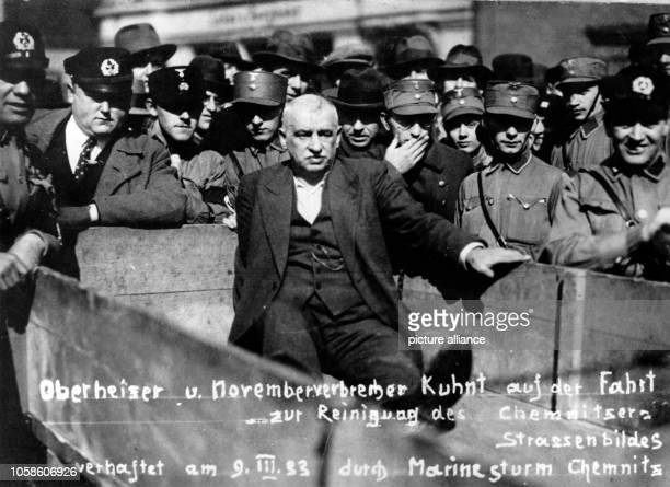 SPD politician Bernhard Kuhnt is put on display to the public after his arrest by Marine SA troops in Chemnitz Germany 09 March 1933 The text written...