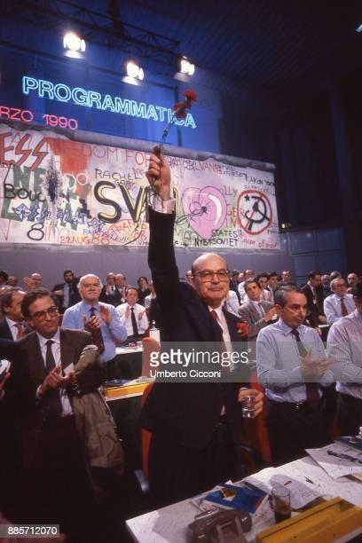 Politician Bettino Craxi hold a carnation flower at the socialist conference Programmatica Rimini 1990 Giuliano Amato is present too