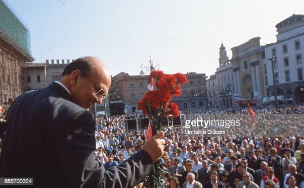 Politician Bettino Craxi holding carnation flowers at the the socialist party conference for the election campaign, Parma 1987.