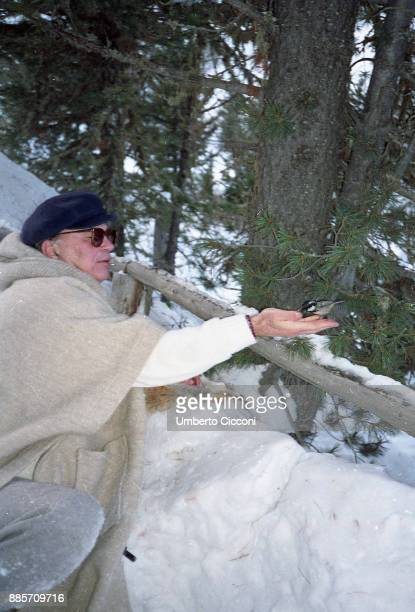 Politician Bettino Craxi holds a little bird in his hand, St. Moritz 1990.