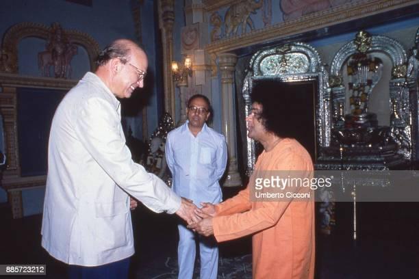 Politician Bettino Craxi is with his brother Antonio Craxi and Indian guru Sathya Sai Baba India 1986