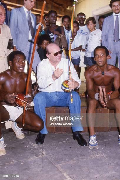 Politician Bettino Craxi plays a berimbau with Basilian people in Salvador 1987