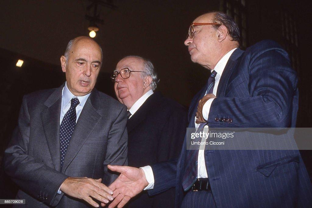 Politician Bettino Craxi shakes hand of Giorgio Napolitano, Giovanni Spadolini is also present, Rome 1989.