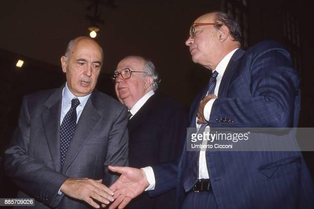Politician Bettino Craxi shakes hand of Giorgio Napolitano Giovanni Spadolini is also present Rome 1989