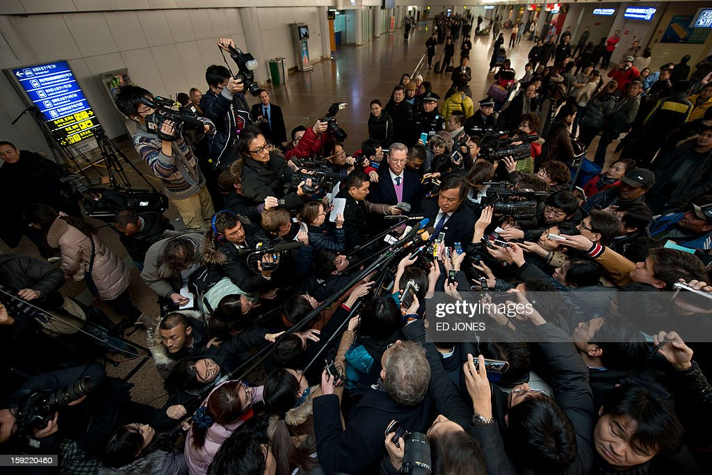 US politician Bill Richardson (C) and Google chairman Eric Schmidt (centre L) talk to the media after arriving at Beijing airport from North Korea on January 10, 2013. Richardson and Google chairman Eric Schmidt met with reporters following their visit to secretive North Korea calling for greater Internet freedom for the welfare of its people. AFP PHOTO / Ed Jones