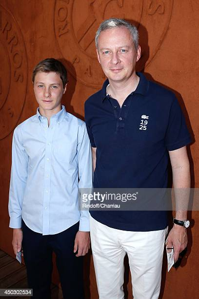Politician Bruno Le Maire and his son Louis attend the Men's Final of Roland Garros French Tennis Open 2014 Day 15 on June 8 2014 in Paris France