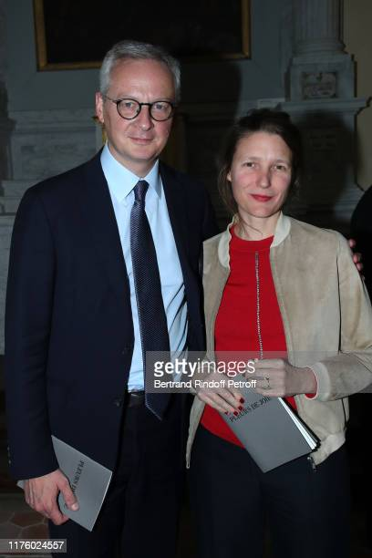 Politician Bruno Le Maire and his wife Pauline Doussau de Bazignan attend the Kering Heritage Days opening night at Kering and Balenciaga Company...