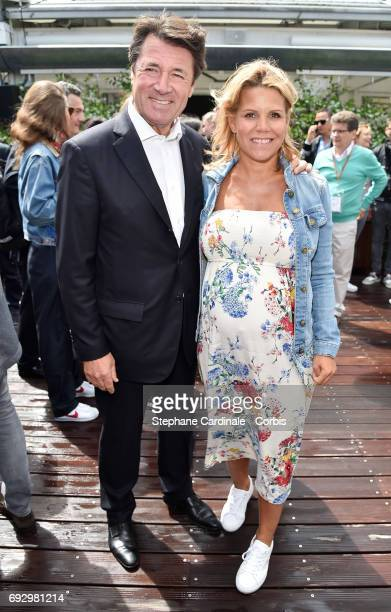 Politician Christian Estrosi and his wife journalist Laura Tenoudji attend the 2017 French Tennis Open Day Ten at Roland Garros on June 6 2017 in...