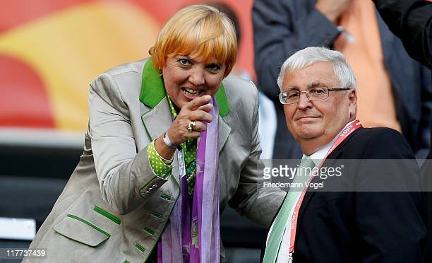 Politician Claudia Roth and Theo Zwanziger of Germany watch the match during the FIFA Women's World Cup 2011 Group A match between Germany and...