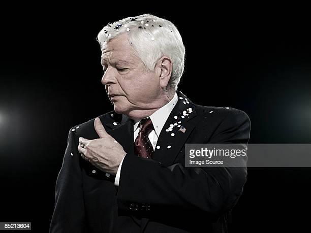 Politician covered in confetti
