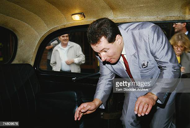 Politician Derek Hatton climbing into a cab during the Labour Party Conference Blackpool 30th September 1986