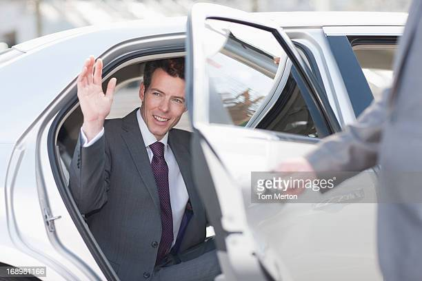 politician emerging from limo - celebrities stock pictures, royalty-free photos & images