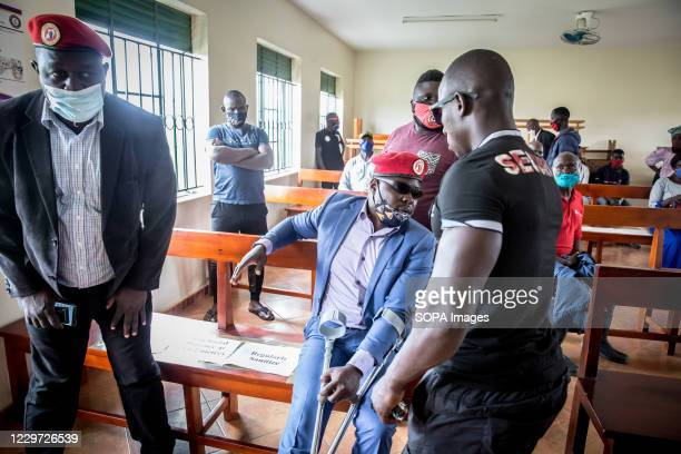 "Politician Francis Zaake sits in Mityana court, where he is challenging his arrest on charges of ""attempted murder"", for trying to distribute food to..."