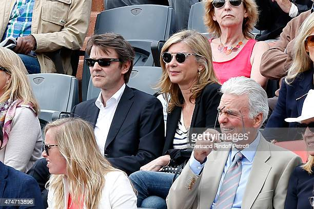 Politician Francois Baroin and his companion actress Michele Laroque attend the 2015 Roland Garros French Tennis Open - Day 2, on May 25, 2015 in...