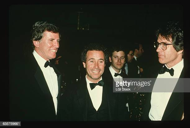 Politician Gary Hart speaks at a party with entertainment mogul David Geffen and actor Warren Beatty