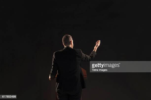 politician giving speech - politician stock pictures, royalty-free photos & images