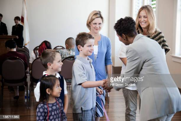 politician greeting children at political gathering - local government building stock pictures, royalty-free photos & images