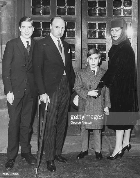 Politician John Profumo with his wife Valerie Hobson and their two sons attending the wedding of Marcia Hare and Michael Hare at St Bartholomew's...
