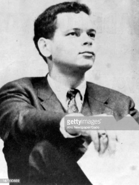 Politician Julian Bond holds a paper as a young man, 1967.