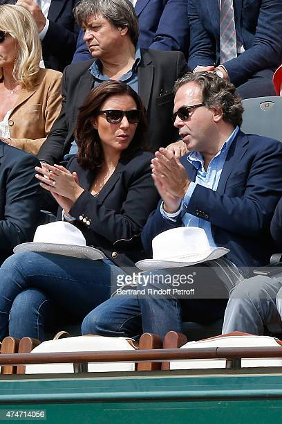 Politician Luc Chatel and his companion Mahnaz Hatami attend the 2015 Roland Garros French Tennis Open Day 2 on May 25 2015 in Paris France