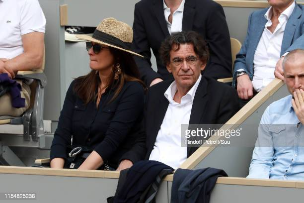 Politician Luc Ferry and his wife MarieCaroline Becq de Fourquieres attend the 2019 French Tennis Open Day Fifteen at Roland Garros on June 09 2019...