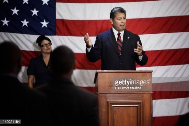 politician making speech at podium - 政治家 ストックフォトと画像