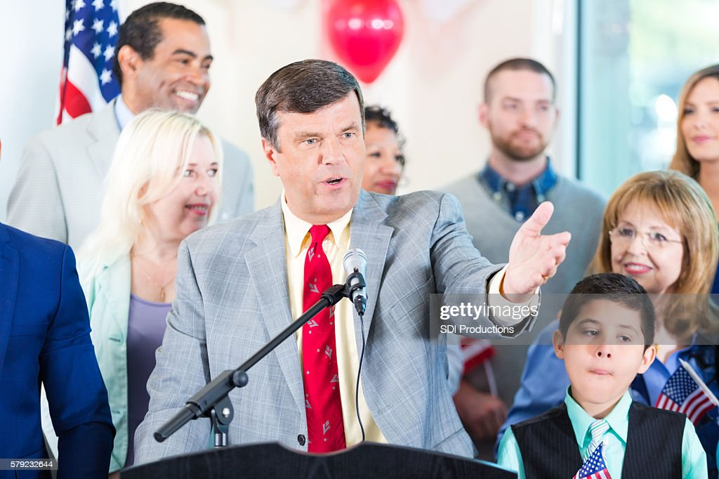 Politician making speech with supporters : Stock Photo
