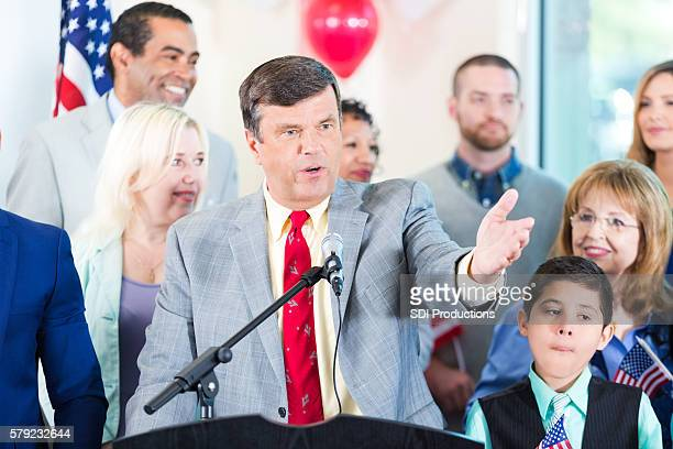 politician making speech with supporters - local politics stock pictures, royalty-free photos & images