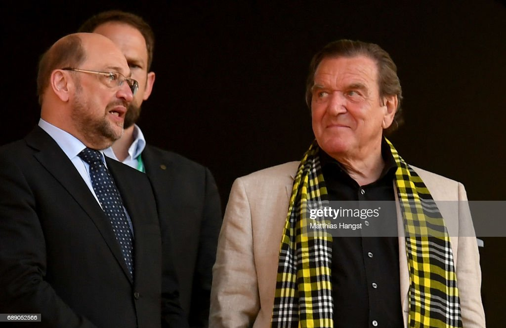 SPD politician Martin Schulz (L) and former chancellor of Germany Gerhard Schroeder (R) look on prior to the DFB Cup Final 2017 between Eintracht Frankfurt and Borussia Dortmund at Olympiastadion on May 27, 2017 in Berlin, Germany.