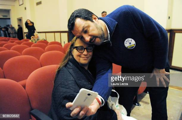 Politician Matteo Salvini leader of the Lega Nord Party takes photos with his supporters after attending a political rally on February 23 2018 in...