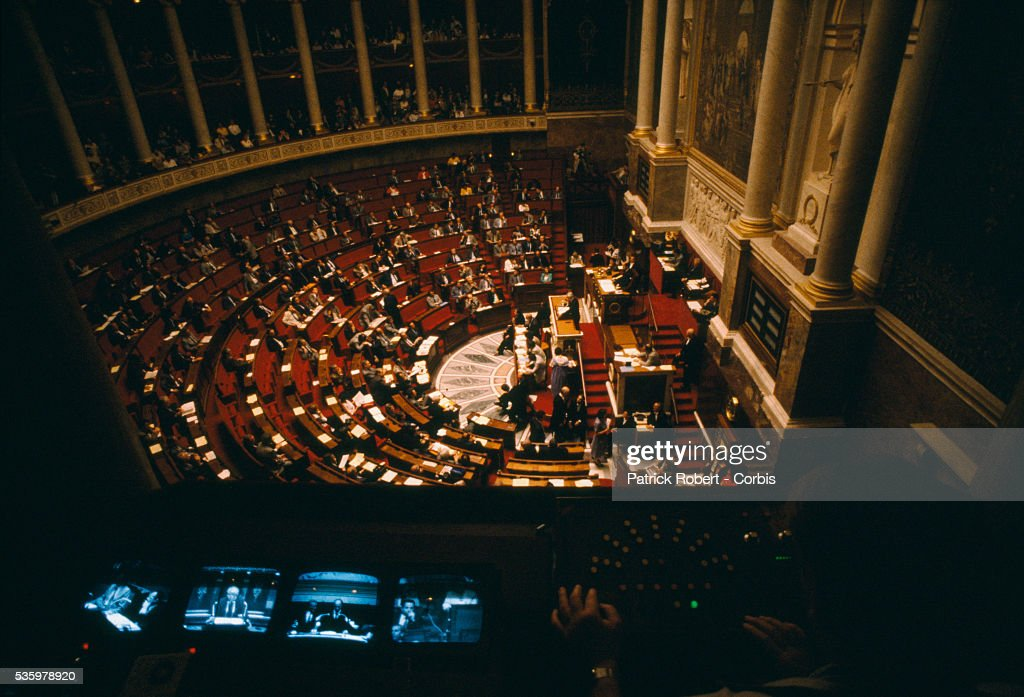 Politician Michel Rocard gives a speech before the French National Assembly. The Assembly's legislative chambers are in the Palais Bourbon in Paris.