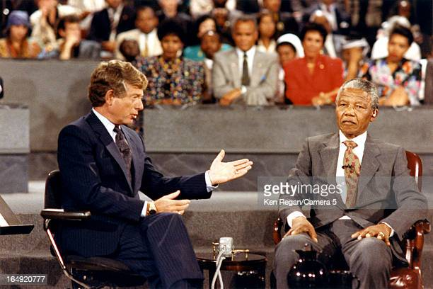 Politician Nelson Mandela and news anchor Tedd Koppel are photographed durning 'The Ted Kopple Report A Town Meeting with Nelson Mandela' on June 21...