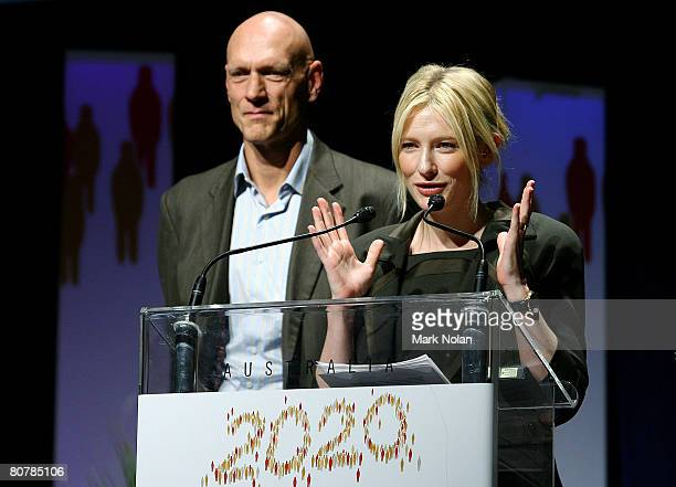 Politician Peter Garrett and actress Cate Blanchett of Australia address the audience during the Summation and close in the Great Hall on day two of...