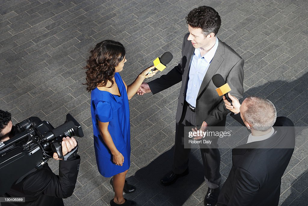 Politician talking to reporters : Stock Photo