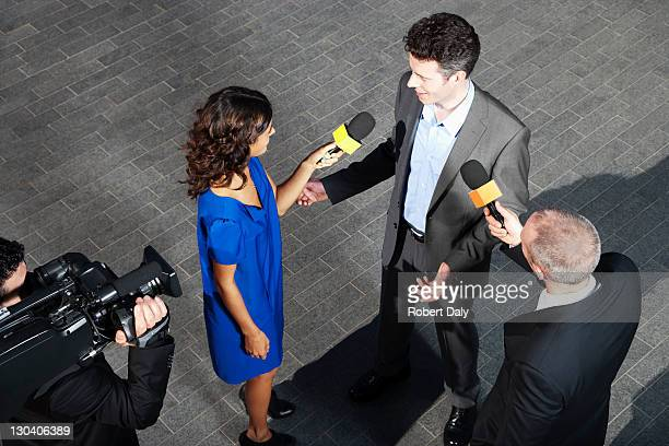 Politician talking to reporters