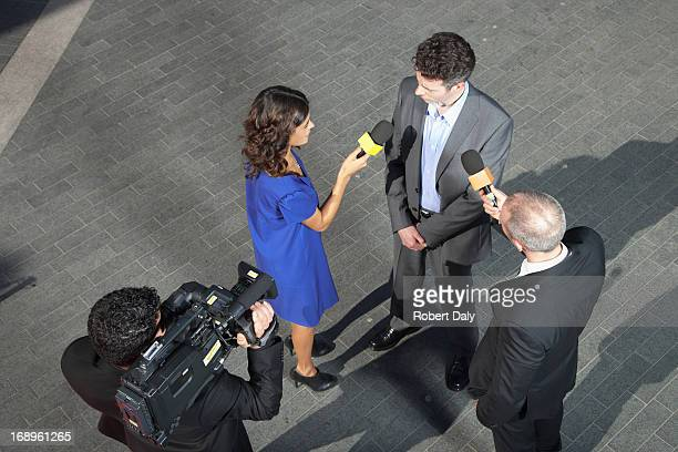 politician talking to reporters - journalist stock pictures, royalty-free photos & images