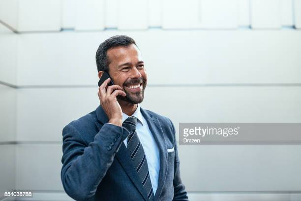 Politician using phone for advice from president
