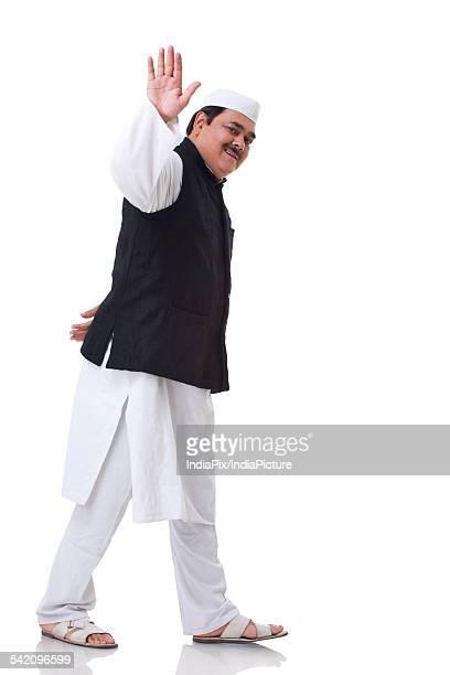 politician waving over white background - indischer politiker stock-fotos und bilder