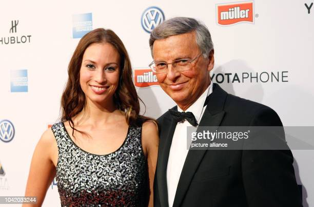 Politician Wolfgang Bosbach and his oldest daughter Caroline pose on the red carpet of the 'Movie meets Media' event at Hotel Atlantic Kempinsky in...