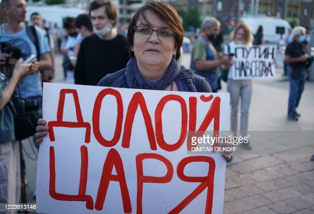 """Politician Yulia Galyamina holding a placard reading """"Down with the tsar"""" protests against amendments to the Constitution of Russia on Pushkinskaya..."""