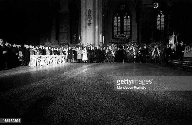 Politicians attending the funeral of the victims of the Train 904 bombing in the Basilica of San Petronio. Among them, the President of the Italian...