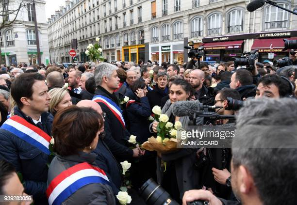 Politicians including Les Republicans leader Laurent Wauquiez and others prepare to take part in a slient march in Paris on March 28 in memory of...