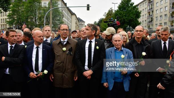 Politicians of the farright Alternative for Germany party Andreas Kalbitz Joerg Urban Bjoern Hoecke and Josef Doerr hold white roses as they...