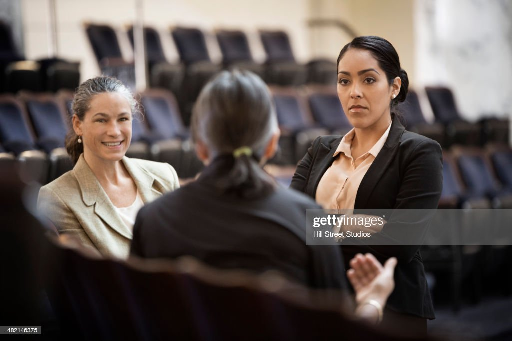 Politicians talking in chamber : Stock Photo