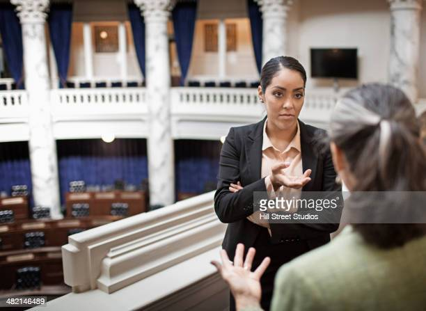 politicians talking in chamber - talking politics stock pictures, royalty-free photos & images