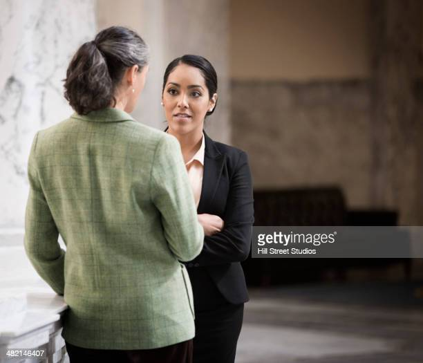 politicians talking in government building - women politics stock pictures, royalty-free photos & images