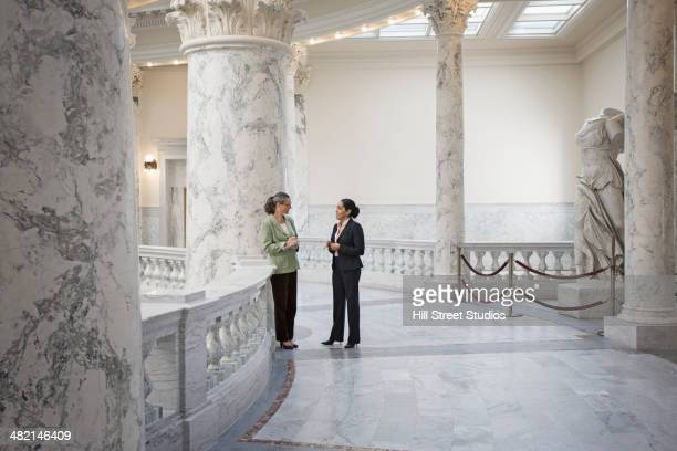 Politicians talking in government building