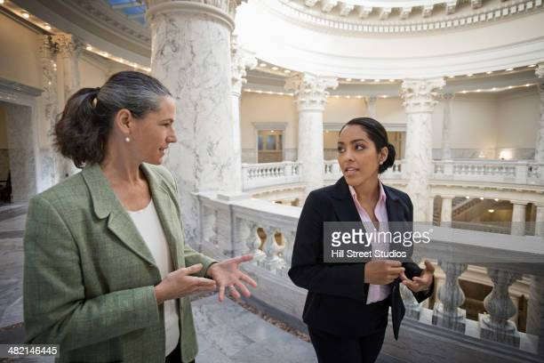 politicians talking in government building - government stock pictures, royalty-free photos & images